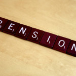 Scrabble game pieces spelling out pension