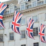 Union Jack flags strung between buildings